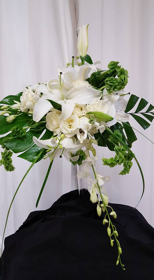 Alexs flowers bridal bouquet of lavender and ivory roses white calla lilies and freesia and plum carnations finished with an ivory chiffon hand wrap and family rosary mightylinksfo