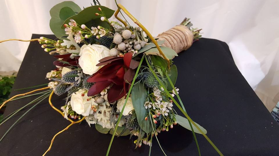 Elegant Simple Bridal Bouquet Of Blush And Ivory Roses With An Chiffon Hand Wrap Accented Crystal