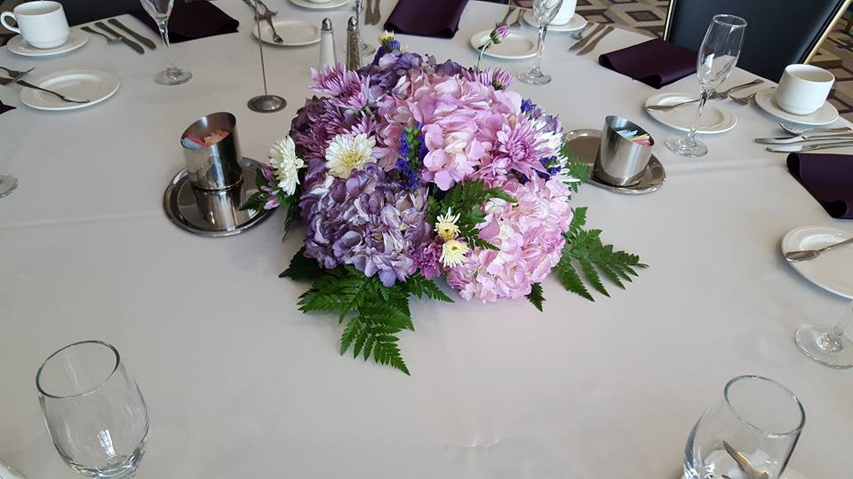 Beautiful Round Low Centerpiece Of Purple Hydrangea Mums And Statice