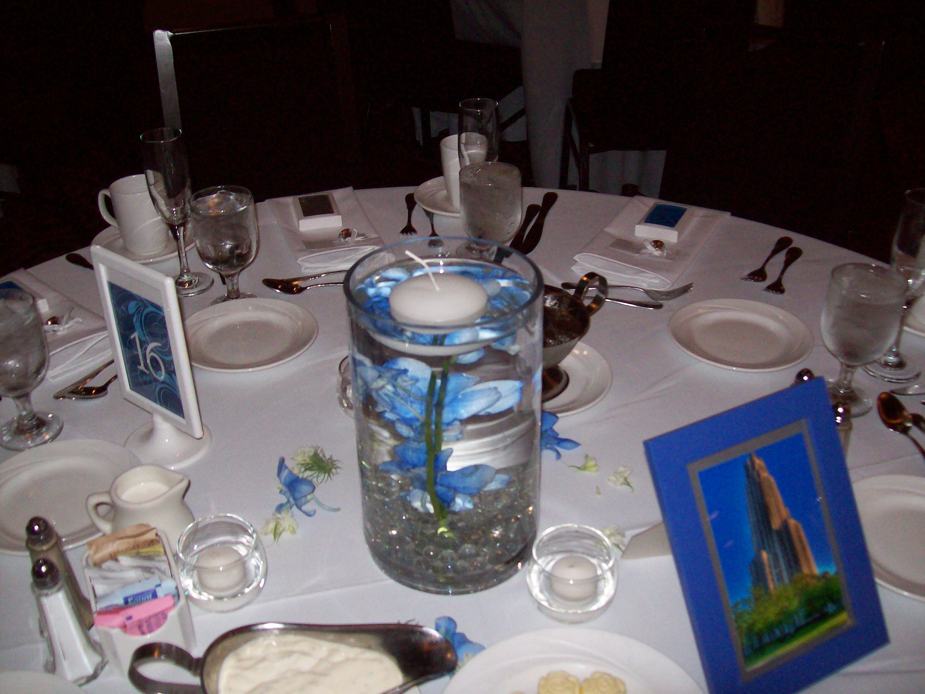 Alexs flowers submerged light blue dendrobium orchids in cylinder vase with gemstones and floating candle vase gems and candle rental reviewsmspy