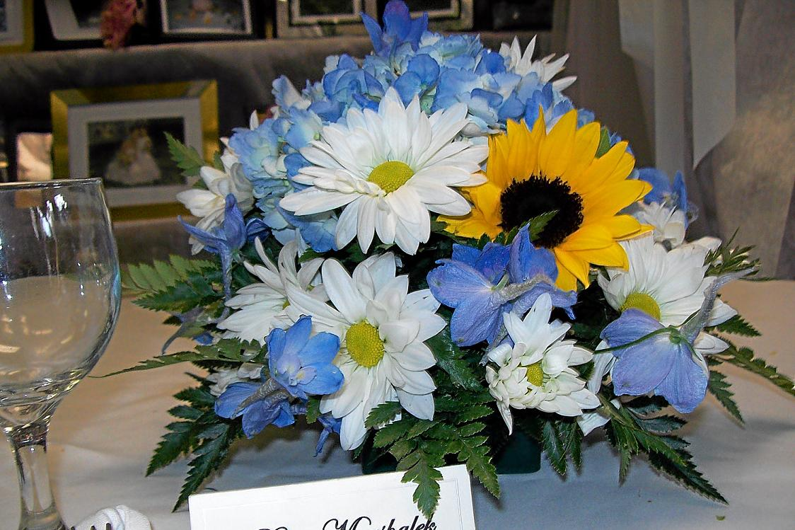 Round Centerpiece With Sunflowers Daisies And Delphinium